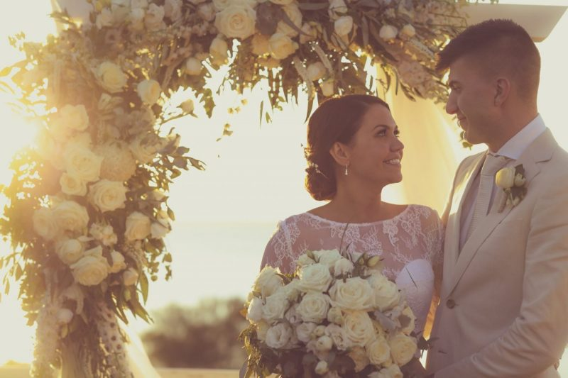 Arbour as sun setting bride and groom